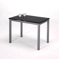 Mesa de cocina de cristal negro con alas extensibles.